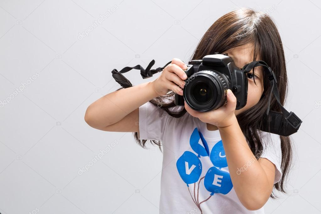 depositphotos_80394672-stock-photo-little-girl-camera-little-girl
