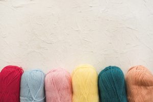 row-of-colorful-skeins-of-yarn_23-2147930364