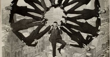 photo-manipulation-before-digital-age-man-on-rooftop-with-eleven-men